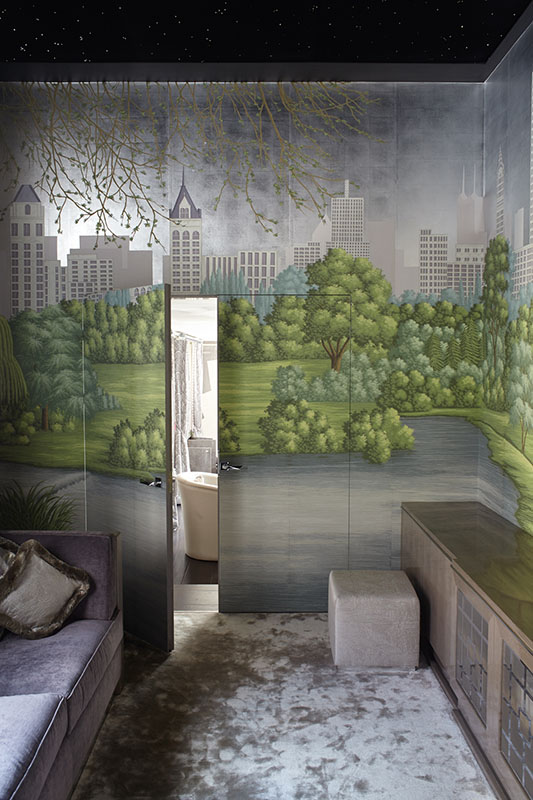Room entirely decorated with city landscape wallpaper