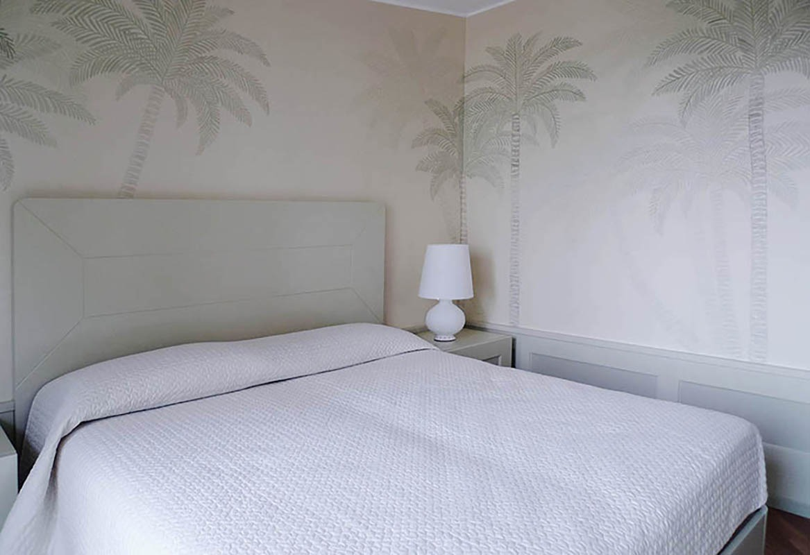 delicate palm for bedroom wallcoverings on white background