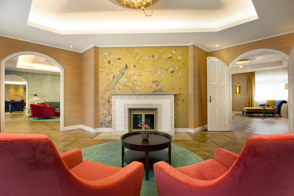 hand painted silk wallcovering for lobby hotel kempinski with oriental garden design with peacocks
