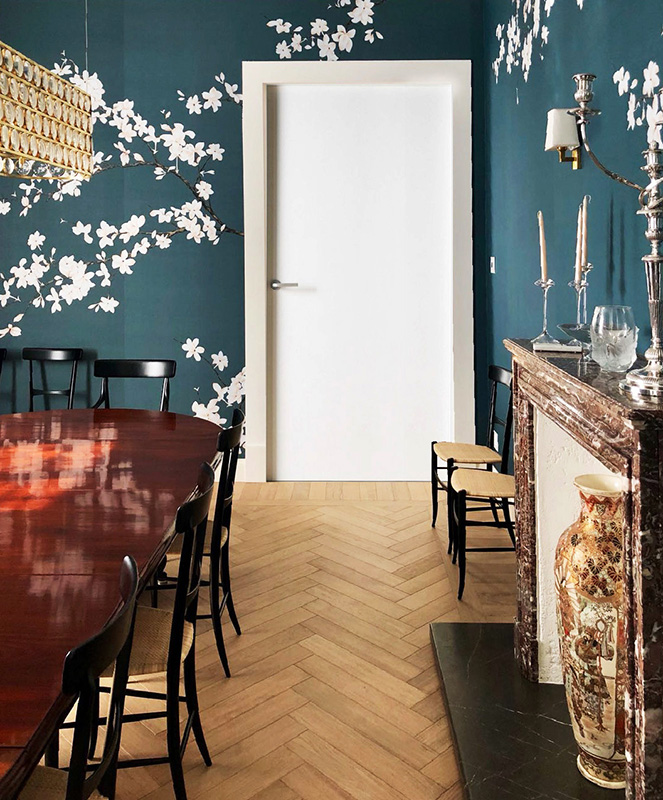beautiful white magnolia details for dinning room with blue silk wallpaper