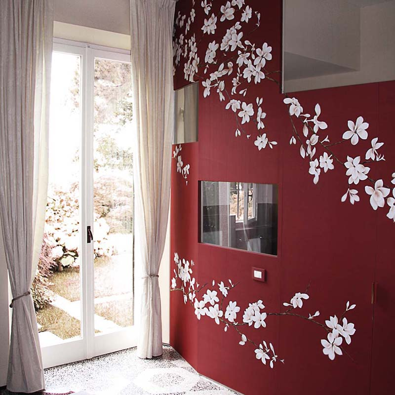 beautiful entrance with red silk wallcoverings combine with white japanese flowers