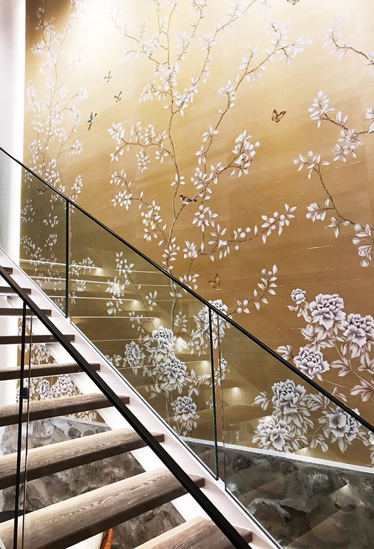 details on japanese silk wallcoverings with gold colour nuance and oriental flower design