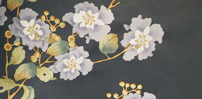 Flower painted on a dark colored wallcovering
