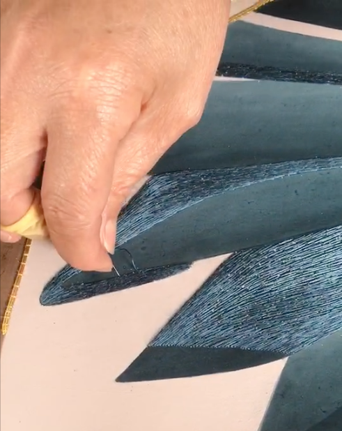 hand embroidery details of cabana wallpaper with our artisan in factory